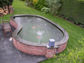 Kidney shaped pond fibreglassed by GRP photo 10