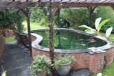 Kidney shaped pond fibreglassed by GRP photo 12